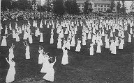 Triumph of Spring Dance at University of Washington with women dancing and posing on lawn, Triumph...
