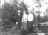 Three young women posing in field, University of Washington's Marine Station at Friday Harbor, San...