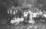 Group of twenty-nine people posing in a field, University of Washington's Marine Station at Friday...