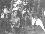 Group of six young women sitting outdoors, University of Washington's Marine Station at Friday...
