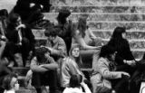 Abortion rights activists sitting on steps in the Washington State Capitol rotunda during rally in...