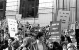 Protesters making peace signs and holding signs during the Vietnam Moratorium demonstration in...