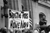 "Crowds holding a sign that reads ""Bring the Troops Home Now"" at a Moratorium March..."