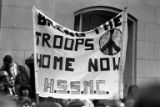 "Crowds at a Moratorium March carrying a sign that reads"" Bring the Troops Home Now"" in..."