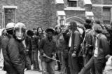 Police in riot gear monitoring a protest in opposition to the Vietnam War at the University of...