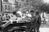 Students handing out bread during a protest in opposition to the Vietnam War at the University of...