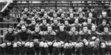 Navy football team sitting on bleachers, U.S. Naval Training Station at University of Washington,...