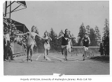Runners crossing finish line at Denny Field, University of Washington, ca. 1915