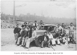 1929 Campus Day showing students with car, University of Washington