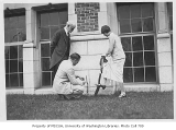 Edmond Meany and two students planting ivy, University of Washington, ca. 1925