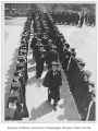 Faculty walking between rows of graduates, University of Washington, June 12, 1932
