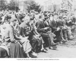 Group of people seated in a crowd on Campus Day, University of Washington, Seattle, April 21, 1922