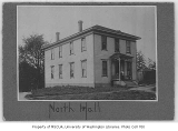 Territorial University's North Hall with people on porch, n.d.