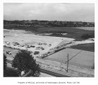 Tennis courts and Montlake Landfill, birds-eye view looking northeast across Montlake Boulevard,...