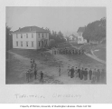 Territorial University showing cadets drilling among campus buildings, 1895