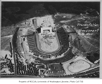 Aerial of Husky Stadium during ceremony, University of Washington, 1925