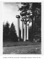 Children in grass near columns, University of Washington, ca. 1915