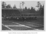 Football rally with The Hook as spectators watch at Denny Field, University of Washington,...