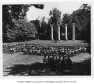 Speaker and audience in front of columns, University of Washington, ca. 1945