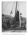 Installation of new flagpole, University of Washington, ca. 1940