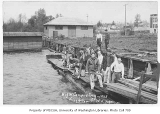 1928 Campus Day showing students working on waterfront, University of Washington
