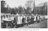 1929 Campus Day showing students at lunch tables, University of Washington