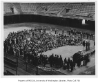 1934 Campus Day showing students gathered inside Edmundson Pavilion, University of Washington