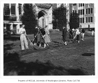 1951 Campus Day showing students working in quad, University of Washington