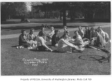 1933 Campus Day showing students eating lunch on grass, University of Washington