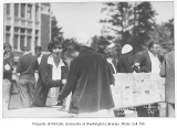 1930 Campus Day showing box lunch distribution, University of Washington