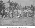1909 Campus Day showing students with tools, University of Washington