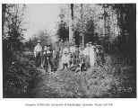 1907 Campus Day showing students in wooded area, University of Washington