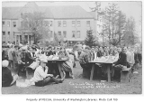 1927 Campus Day showing students at lunch tables, University of Washington