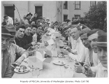 1910 Campus Day showing students eating lunch, University of Washington