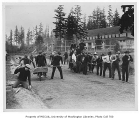 1907 Campus Day showing students at work near armory and gymnasium, University of Washington