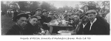 1916 Campus Day showing students eating lunch, University of Washington