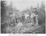 1909 Campus Day showing students in wooded area, University of Washington