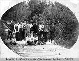 Group portrait of picnic party on plank road, Chautauqua, Vashon Island, n.d.