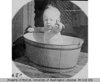A. Eugene Van Olinda as a baby in a washtub, probably Vashon Island, ca. 1903