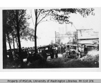 Crowd and automobiles at Heights Grocery Co., Vashon Heights, n.d.