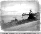 View of coast with sailboat TRILBY, looking northwest from Coupeville, 1900.