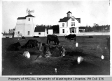 E.J. Hancock farm showing main house, buildings, and cows, south of Coupeville, 1900