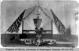 Baptist Church decorated for Memorial Day with flags and G.A.R Women's Relief Corps, H. G. Sickles...
