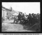 Men playing game of strength at potlatch, Coupeville, Whidbey Island, 1904