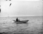 A.H. Waite in a rowboat, Commencement Bay, August 9, 1898