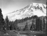 Looking north toward south peak of Mount Rainier and Columbia Crest, with glacial formation,...
