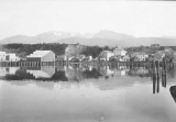 Port Angeles, wharf and waterfront, Olympic Mountains in the distance, June 26, 1895