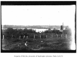 Green Lake waterfront showing a woman and child in a field, Seattle, n.d.