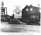 House and billboards on east side of Roosevelt Way, Seattle, n.d.