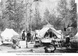 Men in front of the Matthews and Lubelski general merchandise and grocery store tent, Skagway, ca....